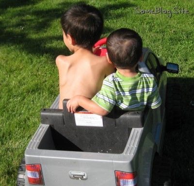 pictures of two boys in a toy truck