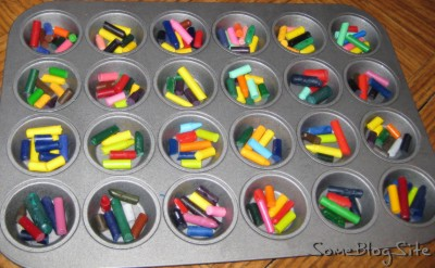 muffin tin of broken, peeled crayons