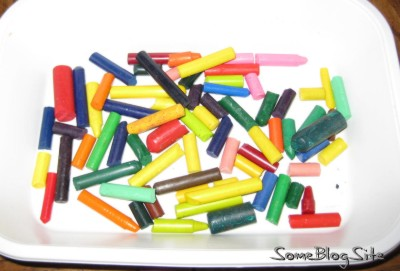 box of broken, peeled crayons