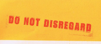 photo of the text DO NOT DISREGARD on an envelope