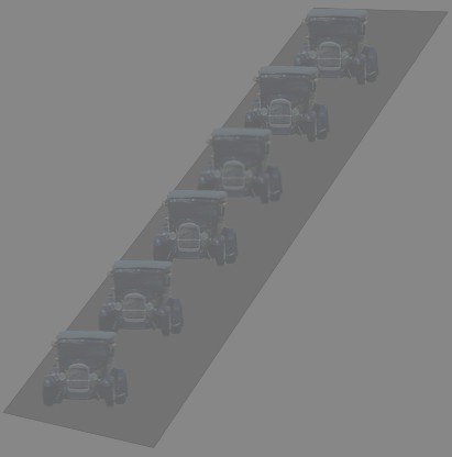 image of cars driving in a line at dusk
