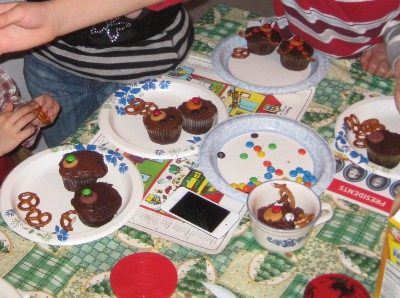 photo of children making cupcakes that look like reindeer