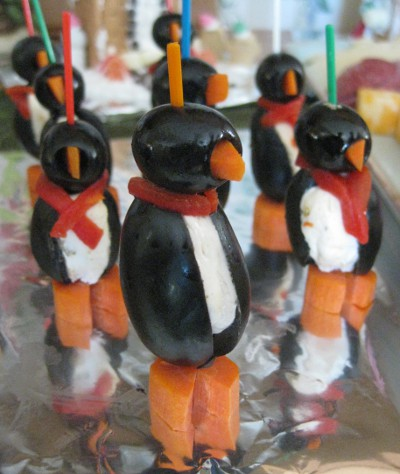 photo of appetizers that look like penguins but are mode from olives
