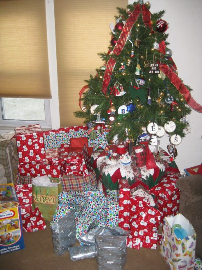 photo of presents and gifts under a Christmas tree
