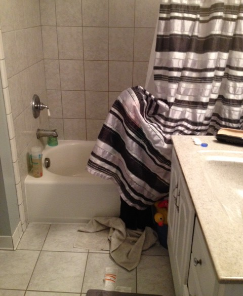 image of a child playing hide and seek in a shower curtain