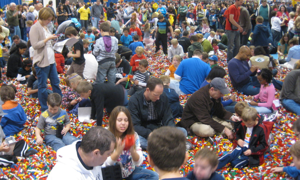 people playing in the big brick pile at the Lego Kids Fest
