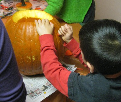 picture of someone carving a pumpkin into a jack-o-lantern