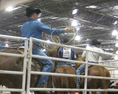 photo of rodeo cowboys practicing with the lasso