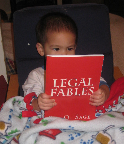 photo of a baby reading Legal Fables
