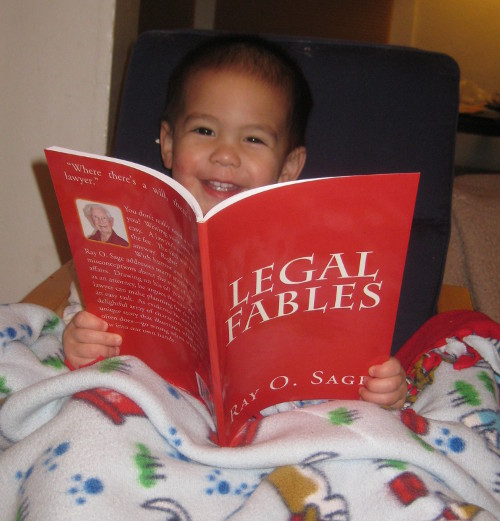photo of a baby happily reading Legal Fables