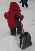 picture of a child pulling a snow shovel