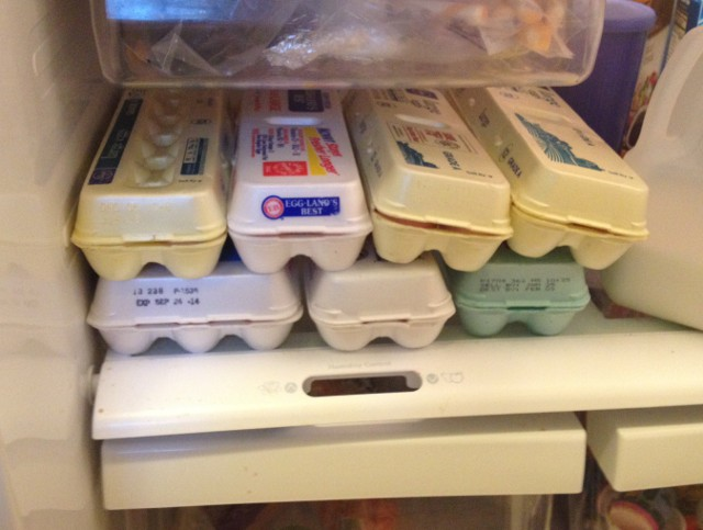 image of several cartons of eggs in our fridge
