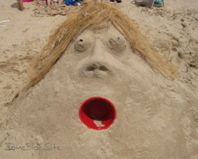 sand sculpture of a woman's head