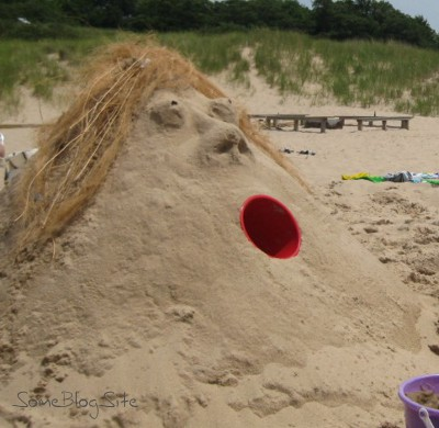 sand sculpture of a lady's head