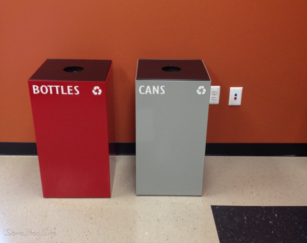 photo of recycling bins labelled bottles and cans