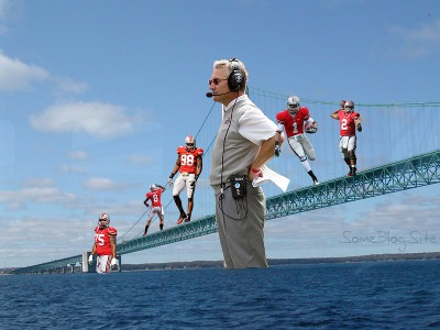 picture of a suspension bridge containing Jim Tressel and 5 Ohio State players who were suspended