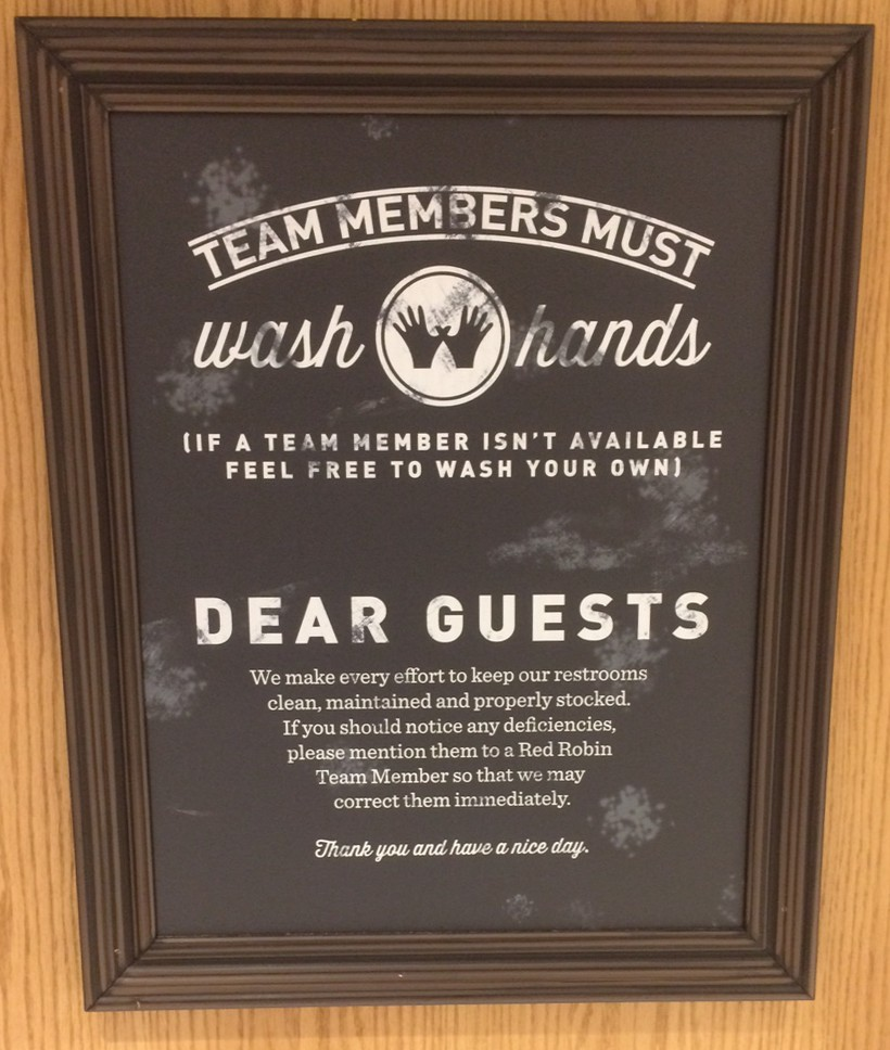 image of restaurants bathroom sign saying that employees must wash hands