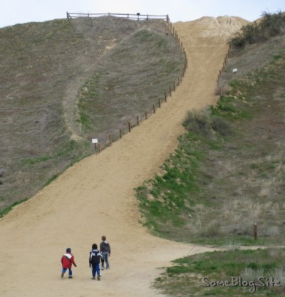 picture of children about to climb a steep hill