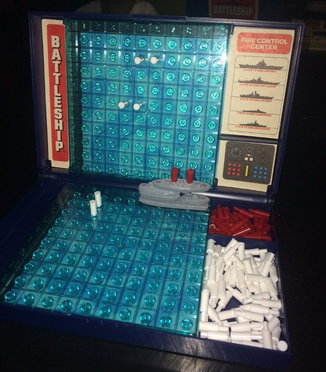 image of a Battleship game with the pieces stacked