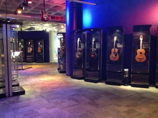 image of museum display of various guitars