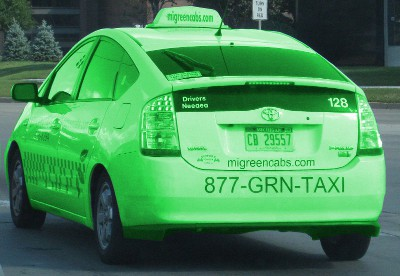 picture of a white car that claims to be a green taxi