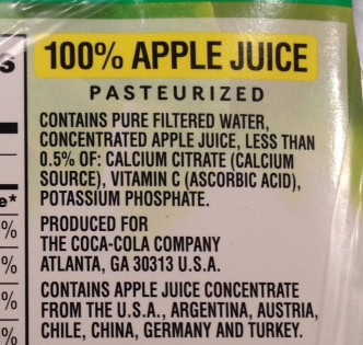 photo of the ingredients list of a box of apple juice labelled as '100% juice'
