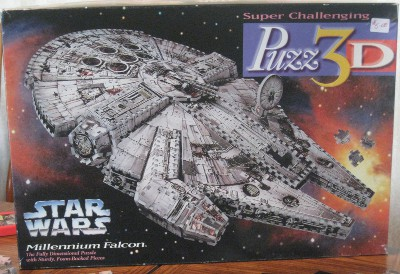 picture of the box for the 3-D puzzle of the Millennium Falcon
