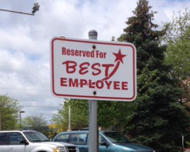 image of an empty parking spot with a sign saying it is reserved for the best employee