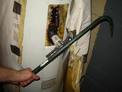 picture of a crowbar strapped to water heater element wrench for leverage