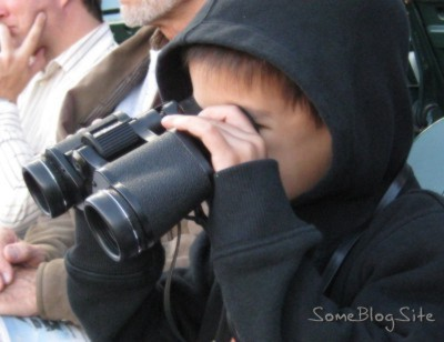 picture of child looking through binoculars