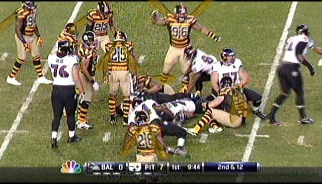 screen shot of the TV during the Pittsburgh Steelers game, with the players having wings on them to resemble bumblebees