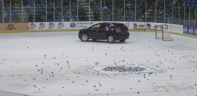 picture of a car driving on the hockey rink