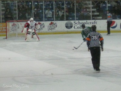 picture of a hockey shootout in action