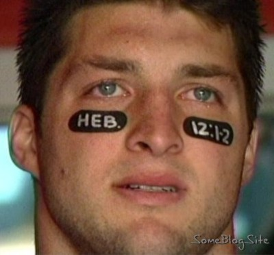 Florida Gator Time Tebow with the Bible verse Hebrews 12:1-2 on his eye black