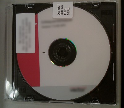 picture of a CD with an unbroken EULA seal
