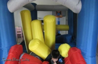 photo of children playing in an inflatable bounce house