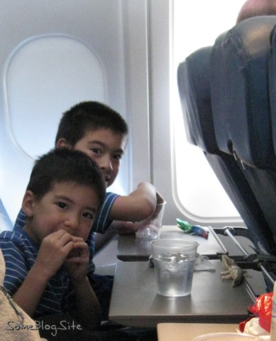 photo of our family enjoying snacks on the plane