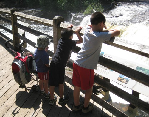 children looking at the lower Tahquamenon Falls