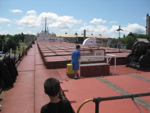 children touring an old Great Lakes freighter