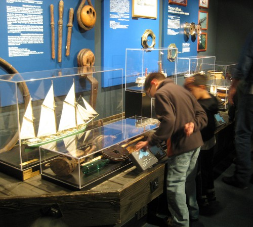 looking at the exhibits inside the Great Lakes Shipwreck Museum