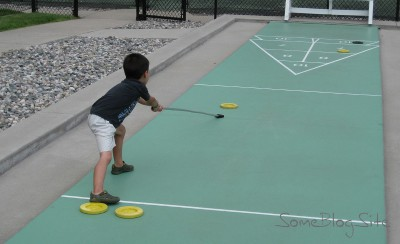 picture of a child playing shuffleboard