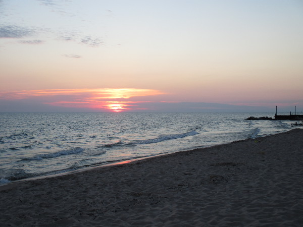 image of the sunset on Lake Michigan at the beach of Maranatha Bible and Missionary Conference in Norton Shores, MI