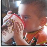 picture of a child drinking from a cup at Buffalo Phil's