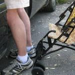 picture of legs and a stroller as seen at the eye level of a young child