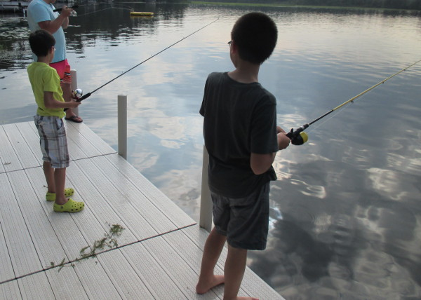 photo of boys fishing off a dock