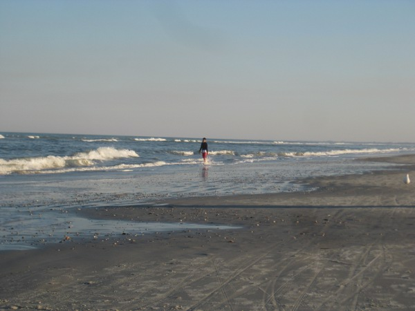 photo of someone walking down the beach in St. Augustine, FL